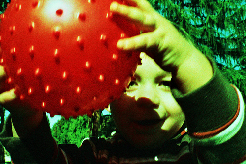 Miles holding a dimple ball - Cross Processed